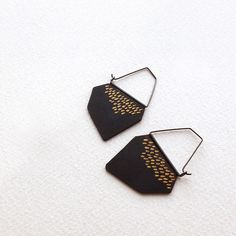 These statement earrings are handcrafted into irregular organic shapes. They are made of copper and sterling silver hook, oxidized in rustic black