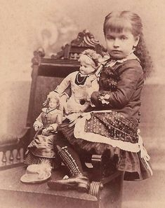 American girl with French Fashion dolls, ca. 1880