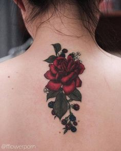 Red rose tattoo on the upper back. Tattoo artist: Olga Nekrasova...