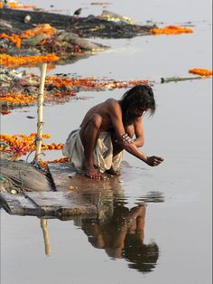 """Ganges River, India  Mark Nepo writes about the Hindu Sage who repeatedly rescues the drowning poisonous spider in the river (getting bitten each time) on page January 18 in A BOOK OF AWAKENING.  His point is that we always find many reasons to be kind. Mark Nepo writes, """"It is the reaching out that is more important than the sting. In truth, I'd rather be fooled than not believe."""""""