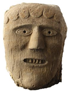 Ancient British Limestone Celtic Pagan Male Head (200 to 600 AD, British), hair falling in strands across his forehead showing his barred teeth, found in Huddersfield, West Yorkshire. The Celts had a predilection for the human head. The 'tete coupée' of the Celts like that of the Gorgon or Medusa of the Mediterranean had apotropaic powers and fulfilled the function of averting evil, and of conferring protection on the building into which they were incorporated.