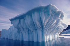 Grounded iceberg.The grooves are caused by air bubbles eroding the ice. Greenland. © Bryan & Cherry Alexander Photography / ArcticPhoto