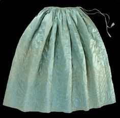 """""""Date: 1750 - 1770 Quilted petticoat made from blue silk which has faded to a green colour. It has wool wadding and a glazed wool lining fabric, and dates from the mid 18th century."""" Collections   Quilt Museum and Gallery, York"""