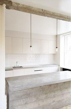 Combining sleek white with rustic wood.