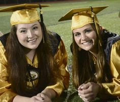 Lillian DeDomenic   For The Tribune-Review Gateway High School graduates Rebecca Supensky and Nicole Kocis relax on the turf following commencement exercises in Antimarino Stadium on Thursday evening, June 2, 2016.