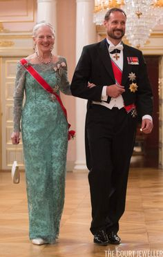 Margrethe wore the sash of the Order of St. Olav, plus the family orders of King Christian IX (her grandfather) and King Frederik IX (her father). She was escorted by Crown Prince Haakon of Norway.
