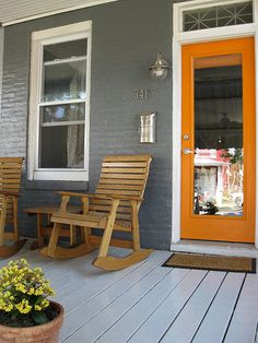 Love the color of siding with orange door. I might just have to paint my house dark grey just so I can have an orange door! Orange Front Doors, Front Door Colors, Orange Power, Porch Flooring, Porch Garden, Cottage Porch, Garden Gate, Grey Houses, House Paint Exterior