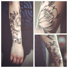Black, white, gray floral tattoo on the forearm.