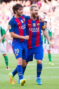 Lionel Messi (R) of FC Barcelona celebrates with his teammate Sergi Roberto (L) after scoring his team's second goal during the La Liga match between FC Barcelona and Real Betis Balompie at Camp Nou on August 20, 2016 in Barcelona, Catalonia.