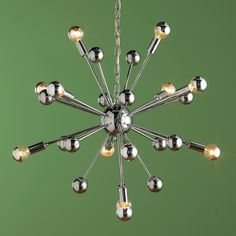 Sputnik Chandelier - 12 Lt Sputnik Chandelier: This 1950's inspired 12-light chandelier adds a unique, retro-modern style to trendy spaces. Silver crown bulbs (included) reflect light inward to create a groovy glow!