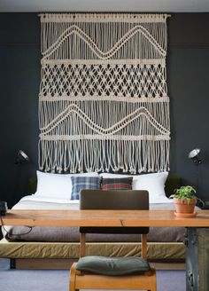 This piece smacks a bit of a Moroccan design flair. Maybe I could put something together like this to take the place of a traditional headboard?
