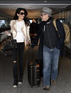 Amal Clooney looked ready for spring weather in an all-beige ensemble as she walked around Columbia University on April 6, 2015. The stunning human rights lawyer and wife of George Clooney showed off her impeccable fashion sense, toting a vibrant red bag that added a pop of floor to her styling outfit.