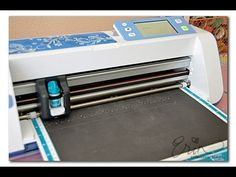 GREAT video that shows how to cut specific items out of preprinted paper. Also shows how to cut your own elements.