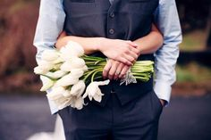 This is cute, but with different flowers. I really love what the groom is wearing.
