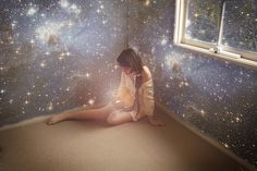 her room was the universe and that was all she needed