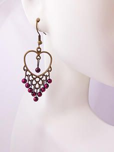 $7.00 - Pretty and understated earrings, very light weight. Antique bronze color with fuchsia faux peals. Shepherd hook style.  #PINKEarrings #PINK #Earrings #PINKPixie   #Nonprofit    All of our proceeds go to educating women in crisis. www.pinkpixie.org