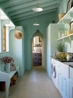 Pastel cottage laundry/mudroom by Eva