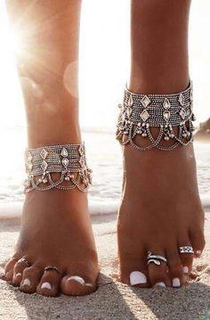 Jeweled ankle bracelets.