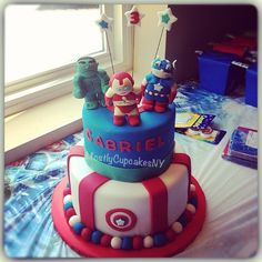 Concept to have three boys on top of cake... Wolverine Spider-Man and captain America and then stars with birthday year 5. 4. 5