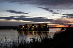 Zambezi Queen by night. A luxury African River Safari on the Chobe River between Botswana and Namibia.