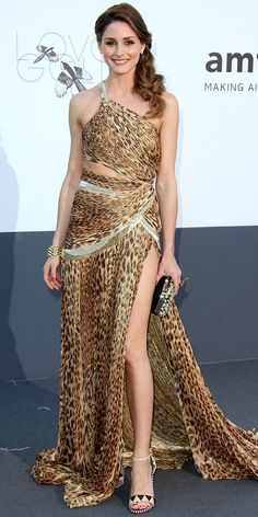 Olivia Palermo showed some skin in a leopard print Roberto Cavalli gown, woven bracelet and tribal sandals at the amfAR Cinema Against AIDS Gala.