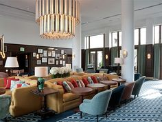 Soho Beach House, Miami.  The unusual shape of this sofa was inspired by a vintage piece. George Smith made four of them in varying sizes to act as a centrepiece in the bar area.
