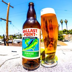 Dorado IPA - Ballast Point Brewing - The aroma is heavenly, starting off with pine, resiny, sappy, and a subtle bitterness. There's also a solid grapefruit peel scent, earthy grassiness, and a strong amber maltiness. Incredible hoppiness with fruity and exuberant pine flavors up front. Backed by a malty and unique bitterness. The mouthful is pleasant, with a nice coating that's dry with moderate carbonation.