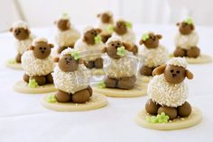 Sheep!  These are made from marzipan (ick) but could maybe make from homemade tuffles and/or candy to be similar.  Cute for a baby shower!