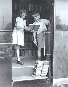 Children looking at books from a mobile library in 1949