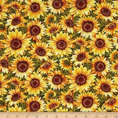 Bountiful Harvest Sunflowers Yellow from @fabricdotcom  From Fabri-Quilt, this cotton print fabric features beautiful fall sunflowers in full bloom. Perfect for quilting, apparel and home decor accents. Colors include metallic gold, shades of brown and yellow, green, army green and light green.