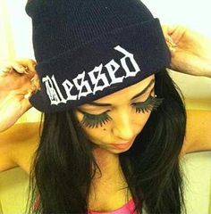 'blessed' beanie...want!! Gah how do girls where fake eyelashes!! I could never, those look hideous!