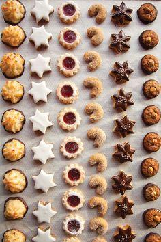 German Christmas Cookies--Kokosmakronen (Chocolate Macaroons), Zimtsterne (Cinnamon/Kirsch), Spitzbuben (Raspberry Jam Filled), Vanillekipferl (Aniseseed Crescents), Schokiladen-Butter-plaetzchen (Chocolate Shortbread), and Nusstaler (Chocolate Hazelnut)!