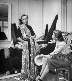 Jacques Fath is draping fabric on himself to help determine his selections.  Photographed by Nina Leen.1951