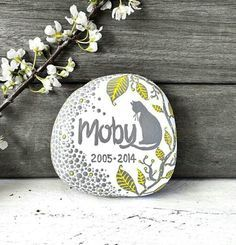 A recent pet memory rock made for a beautiful cat called Moby ❤️ and like OMG! get some yourself some pawtastic adorable cat appa Pet Memorial Stones, Pet Memorial Gifts, Cat Memorial, Memorial Ideas, Pet Caskets, Sea Glass Mosaic, Pet Cemetery, Custom Dog Portraits, Stone Painting