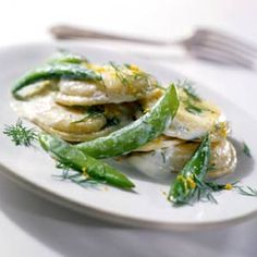 Ravioli And Snap Peas A rich cream sauce tops purchased ravioli for this easy meatless main dish.