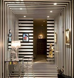 Stripes are timeless design patterns. They can be very difficult to use for decoration. If you need inspiration for using stripes then dive into our post. Black And White Hallway, Black And White Interior, Black White, White Chic, Striped Room, Striped Walls, Striped Hallway, Interiores Art Deco, Interiores Design