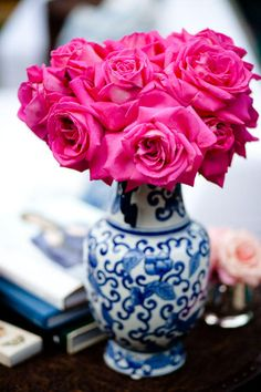 Blue china vase and hot pink roses...yellow and white flowers