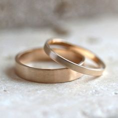 Understated and classic, a simple set of a 4mm x 1mm and a 2mm x 1mm flat band hand forged from 100% recycled 14k yellow gold and given a brushed finish. These rings are made to order in any size 4 - 12 (including half sizes) and will be made especially for you and shipped out within 5