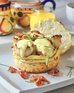 Scallops Benedict with Brown Butter Hollandaise on Chive Buttermilk Biscuits. An indulgent dish fit for for any celebration from birthdays, to Easter to a fancy wedding day brunch. Rock Recipes, Fish Recipes, Seafood Recipes, Cooking Recipes, Easy Cooking, Breakfast Desayunos, Breakfast Dishes, Breakfast Recipes, Breakfast Ideas