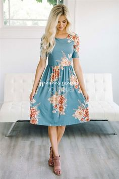 Adorable fit and pretty floral print! You are going to love the Natalie! Dusty blue colored dress features a floral print, half sleeves, a round neckline and elastic waist.