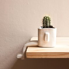 When you think about it, a lonely potted plant looks like it's just sitting there all day contemplating its existence. This becomes even more apparent, when you give the pot legs like these cool new Ceramic Sitting Flower Pots.