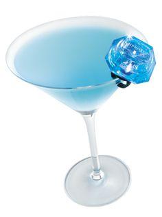 put a ring on it | 1 oz. Hpnotiq      1 oz. Whipped Cream Vodka      Splash of Peach Schnapps      Splash of Lemon-Lime Soda    Instructions    Shake well and strain into a martini glass. Garnish with a Hpnotiq blinking ring.