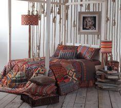 Decoración otoñal de dormitorio con textiles de la colección Edgard