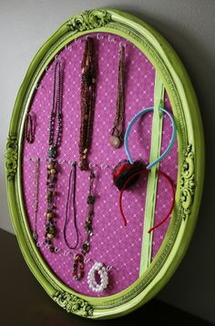 to create a pretty jeweller holder.  Cover a small cork board in fabric, frame, screw in some small hooks and viola….