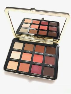 The star of the makeup is of course the Too Faced Just Peachy Velvet Matte Eyeshadow Palette ($45). Think o...