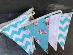 Turquoise and white bunting dark background  Creative Wedding Workshop has a large stock of bunting hire available in the Hampshire and West Sussex area we also offer a postal hire service.  Tithe barn Petersfield, Manor Barn,  Southend Barns, Skylark Country Club, Veils and Bales Hampshire