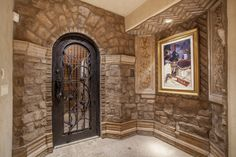 Select a bottle of your favorite vintage from the 1,200-bottle, Tuscan style wine cellar at Shadow Peak. Access this stunning room by either the staircase or home elevator.  #SupremeAuction #LuxuryAuction #Scottsdale #Phoenix #Arizona #ScottsdaleRealEstate #SonoranDesert #ArizonaRealEstate #Troon #TroonVillage #Auction #Artesano #TroonGolf #TroonCountryClub #DesertViews #RealEstate #luxuryrealestate