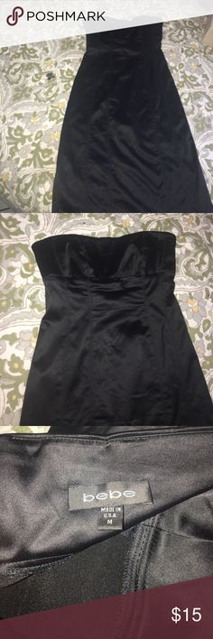 Bebe strapless silky dress Bebe party dress-silky -zipper needs a little bit of fixture -when u zip up the top part gets stuck- overall good dress -no damage to it-used twice bebe Dresses Strapless