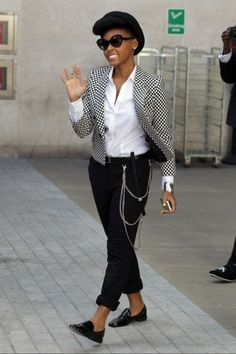Janelle Monae. I want this outfit, minus the chains/hat/shoes. I've always liked blazers & skinny pants/tuxedo pants.
