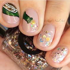 Wow! Check out this awesome New Year's nail art by @ruthsnailart using our exclusive glitter 'Puttin On The Ritz' from #LiveLovePolish.com!